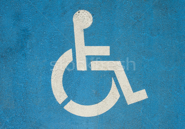 Handicap symbole internationaux handicapés peint blanche Photo stock © cla78