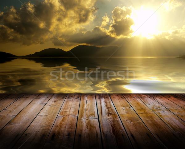 Naplemente padló szépség fapadló tenger égbolt Stock fotó © cla78
