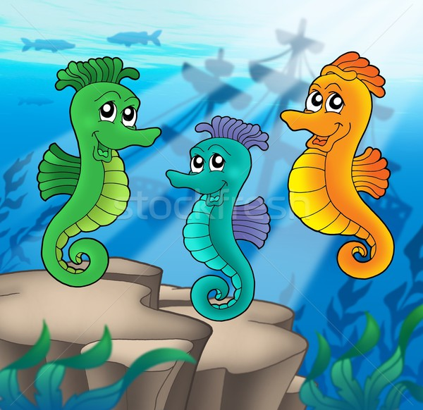 Sea horses family with shipwreck Stock photo © clairev