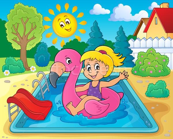 Menina flutuante inflável flamingo feliz sol Foto stock © clairev