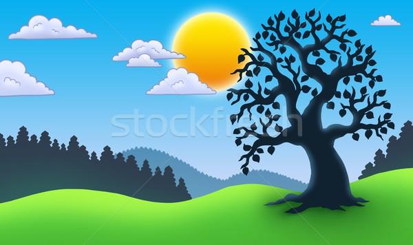 Leafy tree silhouette in landscape Stock photo © clairev