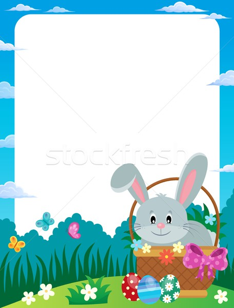Frame with Easter bunny in basket Stock photo © clairev