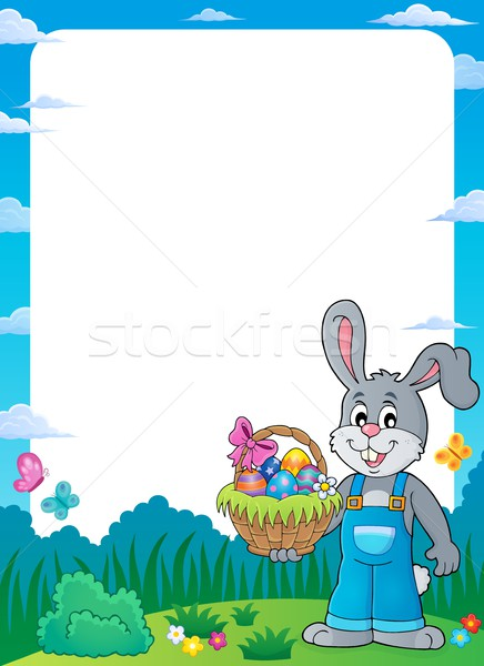 Frame with bunny holding Easter basket Stock photo © clairev