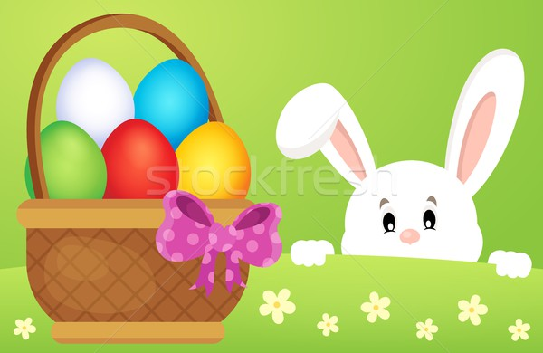 Lurking Easter bunny by basket with eggs Stock photo © clairev
