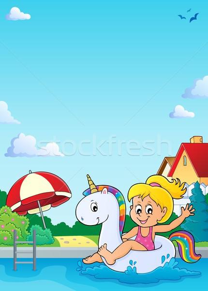 Stock photo: Girl floating on inflatable unicorn 4