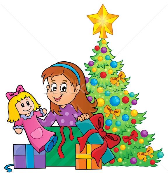 Girl unpacking Christmas gifts theme 1 Stock photo © clairev