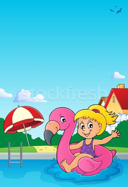 Menina flutuante inflável flamingo feliz criança Foto stock © clairev