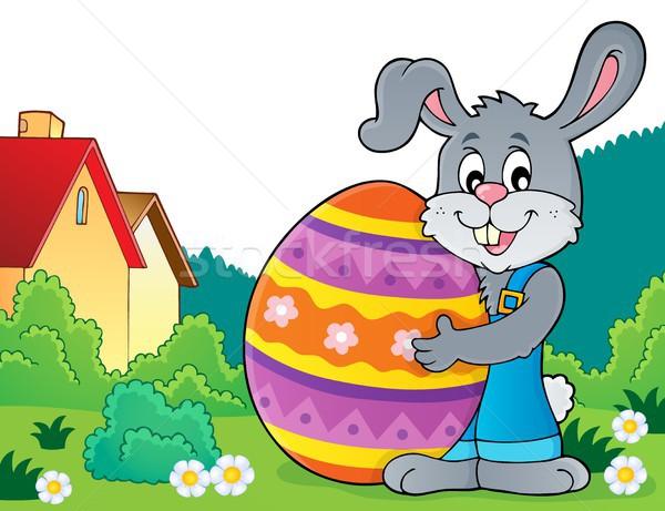 Bunny holding big Easter egg theme 4 Stock photo © clairev