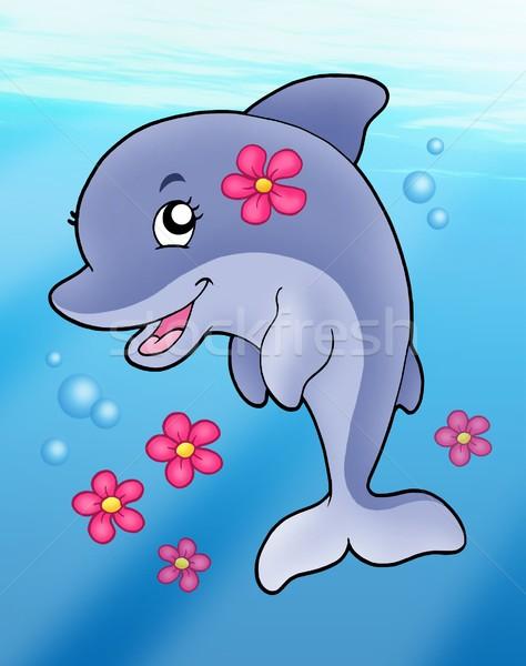 Cute dolphin girl in sea Stock photo © clairev