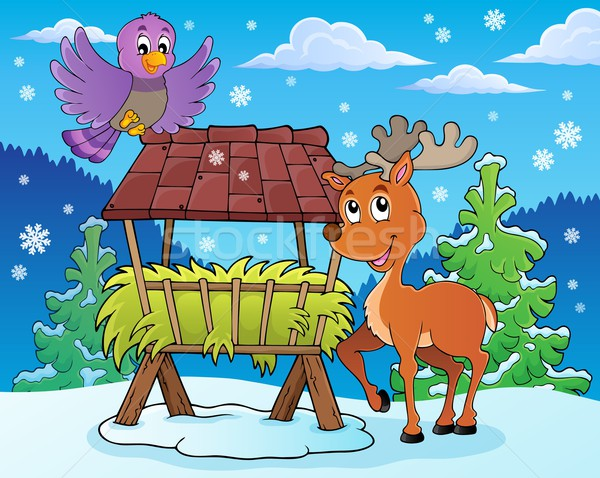 Hay rack with reindeer and bird Stock photo © clairev