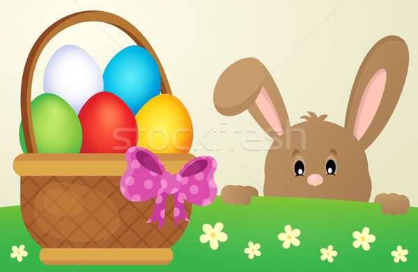 Lurking Easter bunny and egg basket Stock photo © clairev