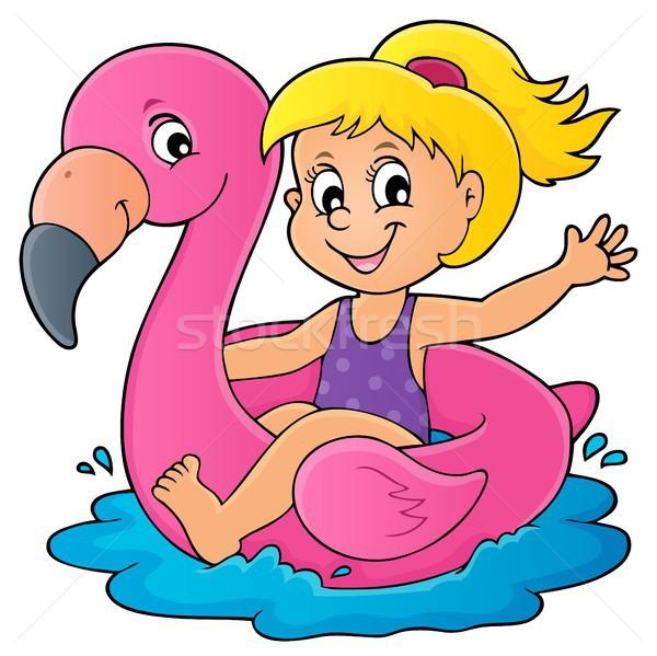 Stock photo: Girl floating on inflatable flamingo 1