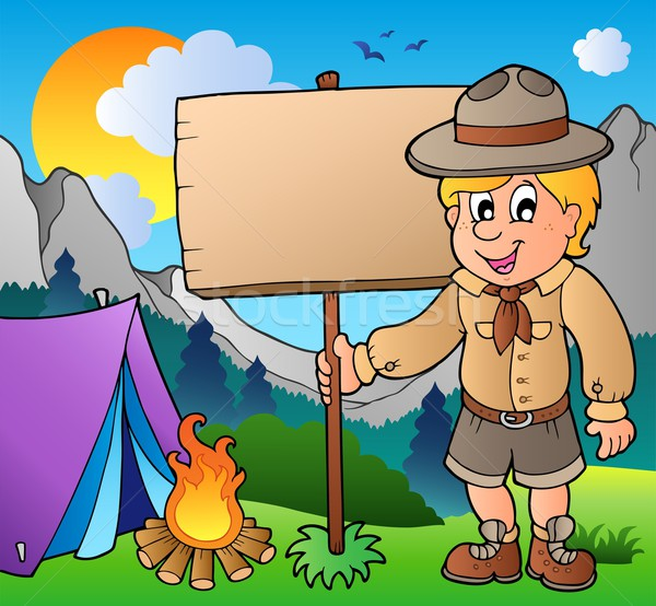 Scout boy holding board outdoor Stock photo © clairev