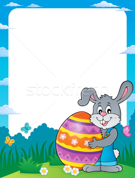 Frame with bunny holding big Easter egg Stock photo © clairev
