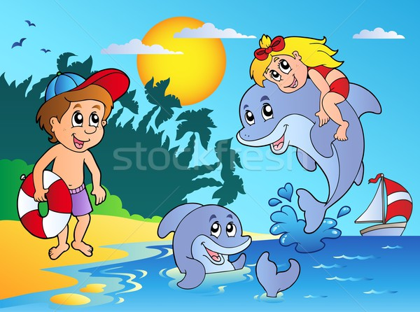 Summer beach with kids and dolphins Stock photo © clairev