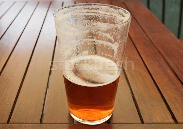 Bira içmek büyük cam pint Stok fotoğraf © claudiodivizia