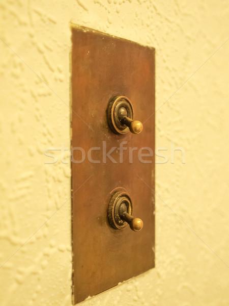 Interrupteur de lumière détail vue électriques mur technologie Photo stock © claudiodivizia
