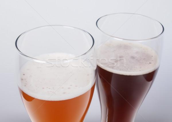 Kettő szemüveg sör sötét fehér Stock fotó © claudiodivizia
