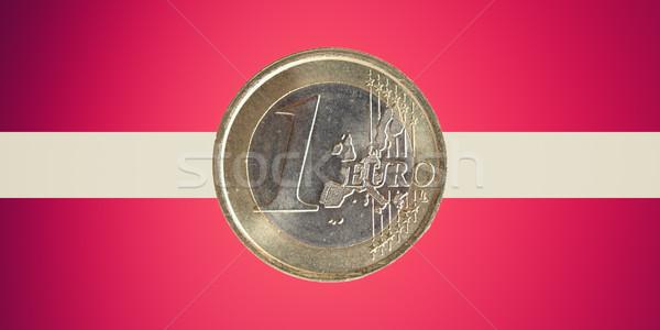 Flag of Lavia with Euro coin Stock photo © claudiodivizia