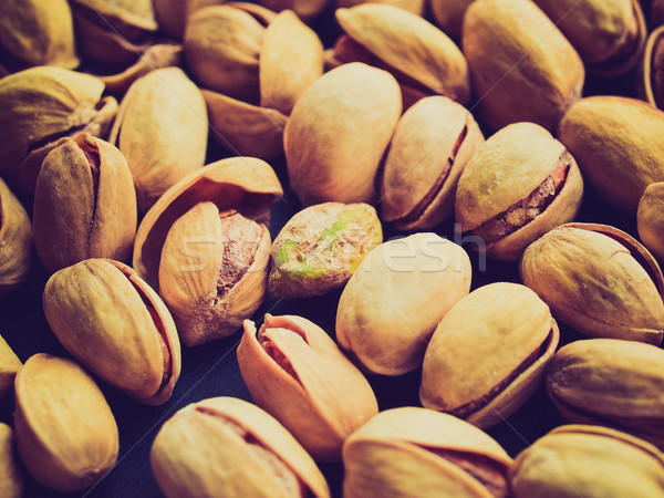 Retro look Pistachios picture Stock photo © claudiodivizia