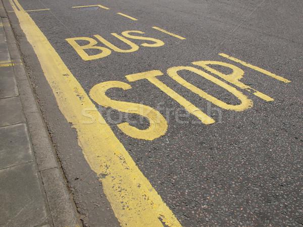 Buszmegálló felirat út utca utazás szállítás Stock fotó © claudiodivizia