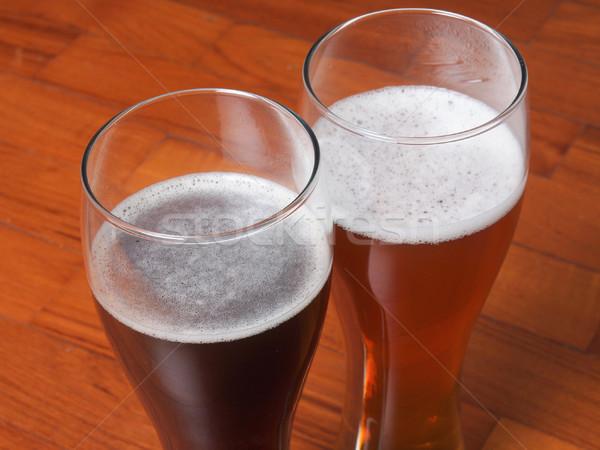 Zwei Gläser Bier dunkel weiß Stock Stock foto © claudiodivizia