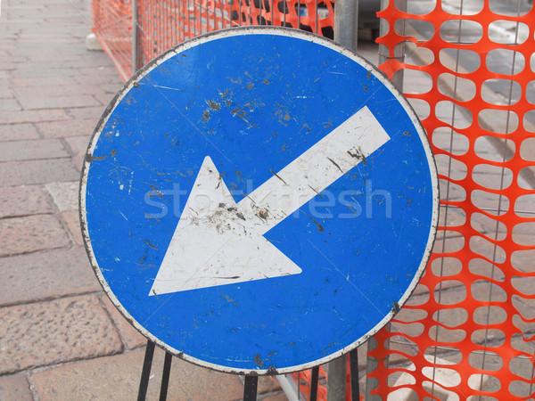 Ok işareti sokak yol sürücü yön Stok fotoğraf © claudiodivizia