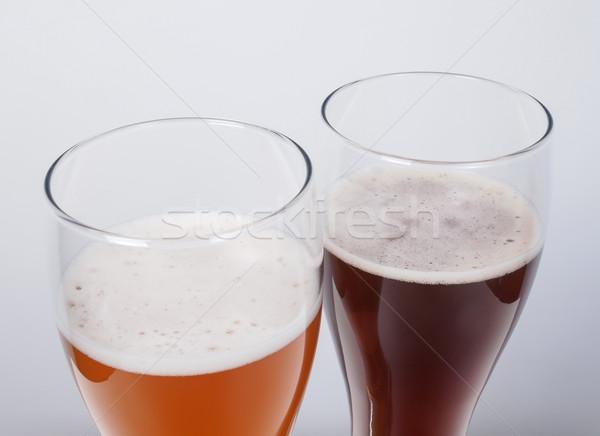 Deux verres bière sombre blanche Photo stock © claudiodivizia