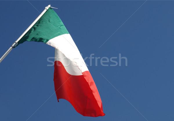 Drapeau italien pavillon Italie ciel bleu fond bleu Photo stock © claudiodivizia