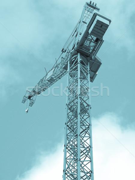 Kran Gebäude Baustelle blauer Himmel cool Himmel Stock foto © claudiodivizia