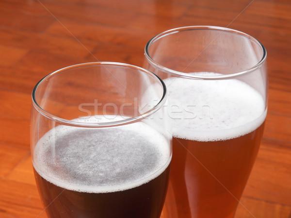 Deux verres bière sombre blanche étage Photo stock © claudiodivizia