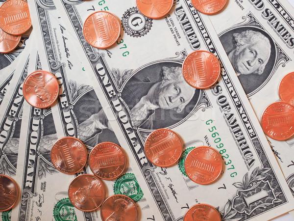 доллара монетами отмечает один цент Сток-фото © claudiodivizia