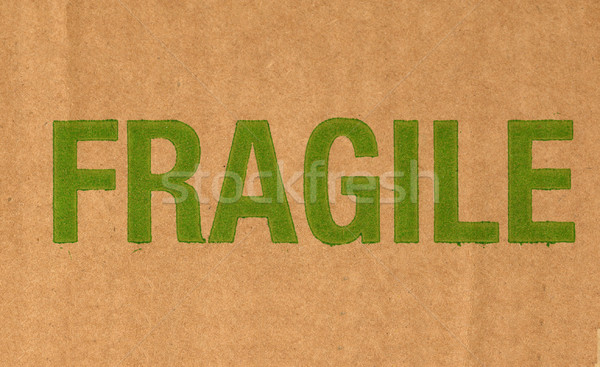 Fragile written on corrugated cardboard packet Stock photo © claudiodivizia