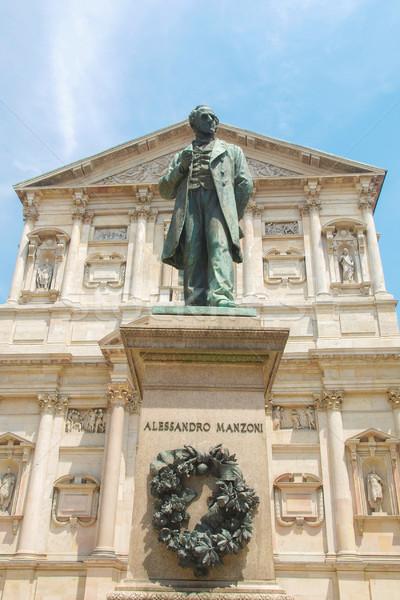 Standbeeld milaan schrijver kerk Italië architectuur Stockfoto © claudiodivizia