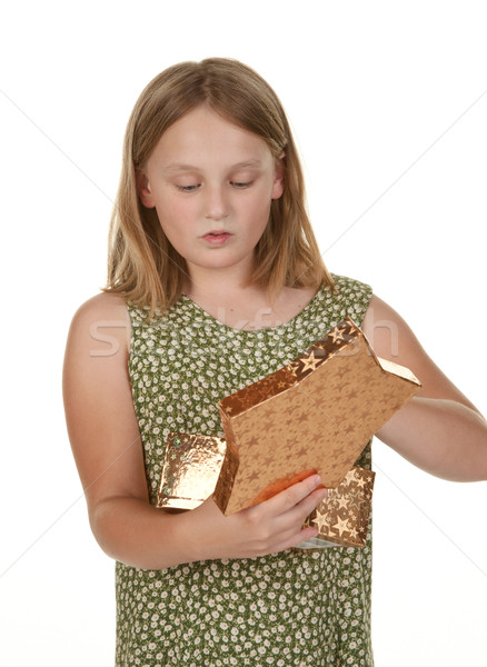 girl opening present on white Stock photo © clearviewstock