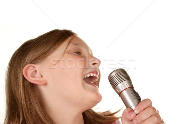 Młoda dziewczyna śpiewu karaoke biały odizolowany dziewczyna Zdjęcia stock © clearviewstock