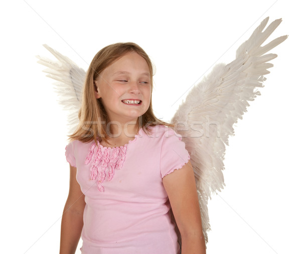 sneaky young girl with angel wings Stock photo © clearviewstock