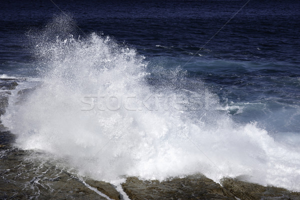 ocean waves crashing on rocks Stock photo © clearviewstock