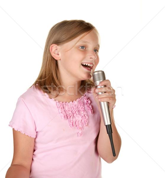 Jovem cantando karaoke branco isolado menina Foto stock © clearviewstock
