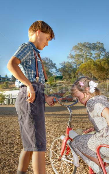 Genç beyefendi küçük kız eski üç tekerlekli bisiklet kız Stok fotoğraf © clearviewstock