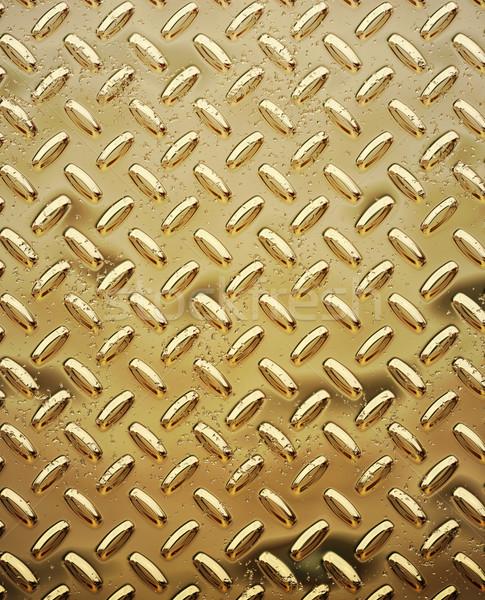 Stock photo: rough gold diamond plate