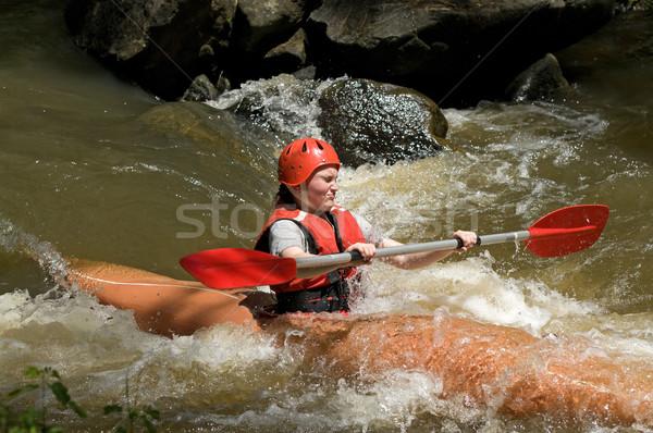 girl white water kayaking Stock photo © clearviewstock