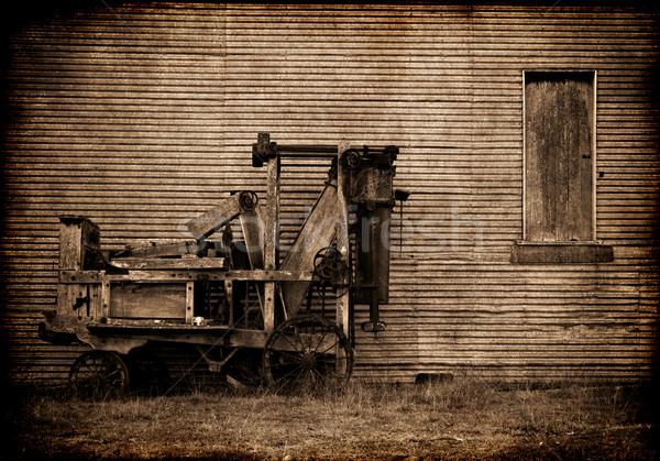 grunge old farm baler Stock photo © clearviewstock
