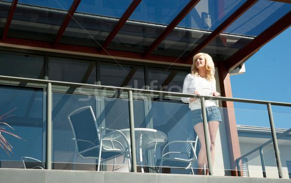 Fiatal nő erkély gyönyörű külső ki ház Stock fotó © clearviewstock