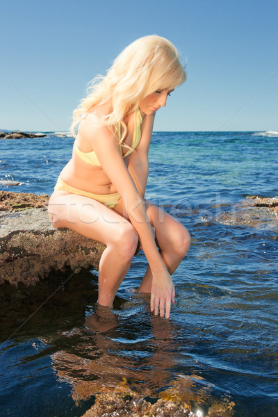 Mulher jovem mar belo rochas mulher água Foto stock © clearviewstock