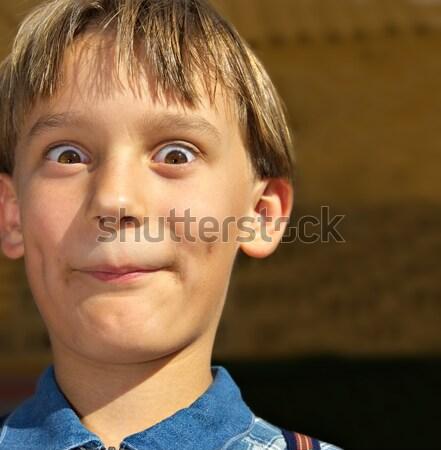 Jongen grote ogen vreemd gezicht Stockfoto © clearviewstock