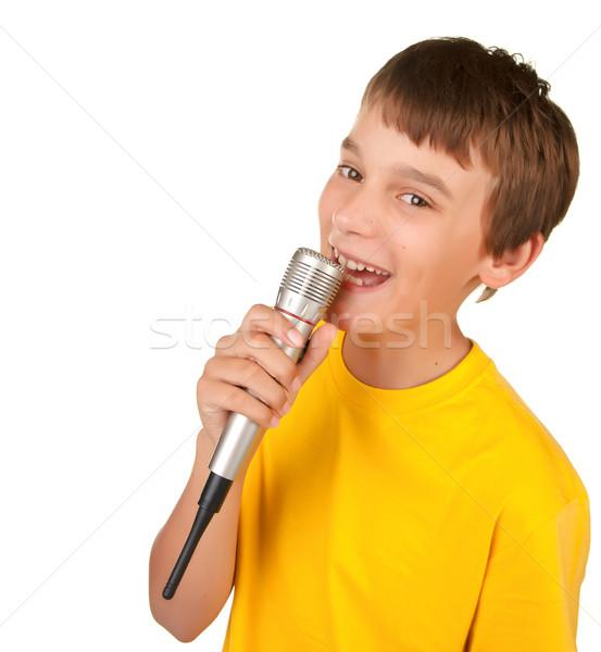 Jongen zingen microfoon geïsoleerd witte Stockfoto © clearviewstock