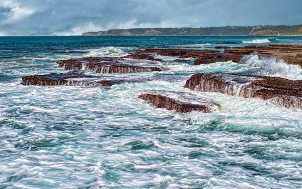 waves on rocks at the coast Stock photo © clearviewstock