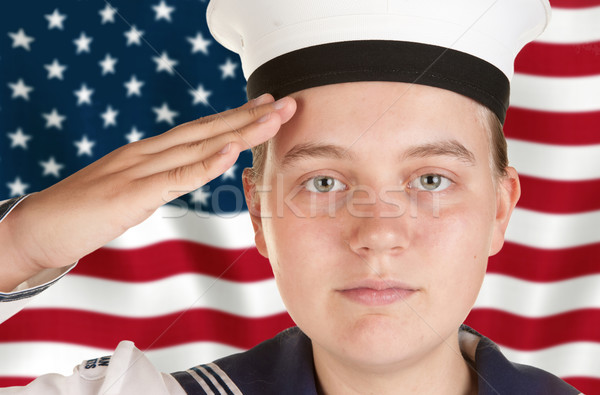 young sailor saluting in front of US flag Stock photo © clearviewstock