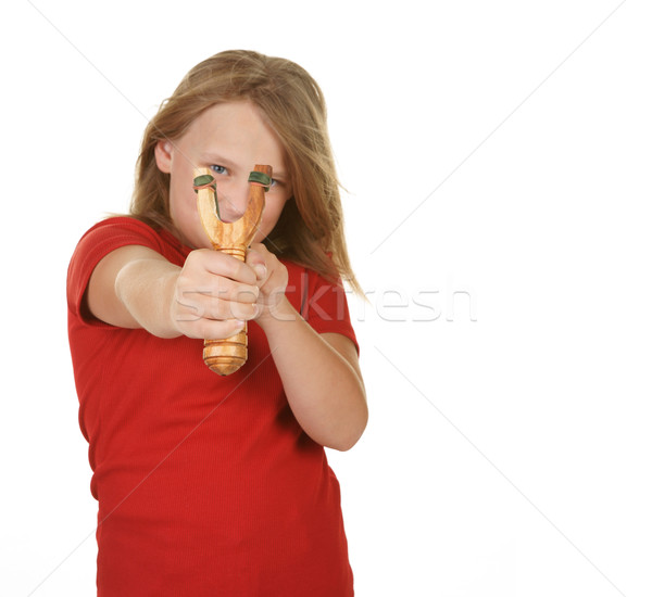 Naughty little girl with a slingshot on white Stock photo © clearviewstock